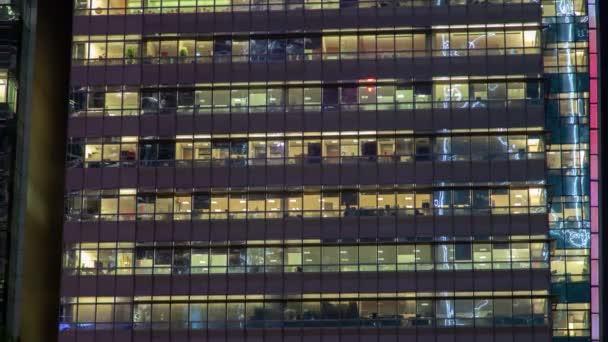 okno vícepodlažní budova ze skla a oceli osvětlení v rámci timelapse