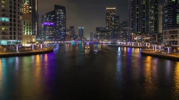 Dubai Marina and water canal night time lapse. pan up