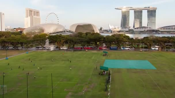Singapore sports field in downtown time-lapse. pan up
