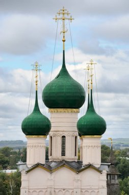 ROSTOV VELIKIY, YAROSLAVL REGION, RUSSIA - Elegant green onion-shaped cupolas of Church of St. John the Divine in Rostov Kremlin. The church was constructed in 1670-1683.