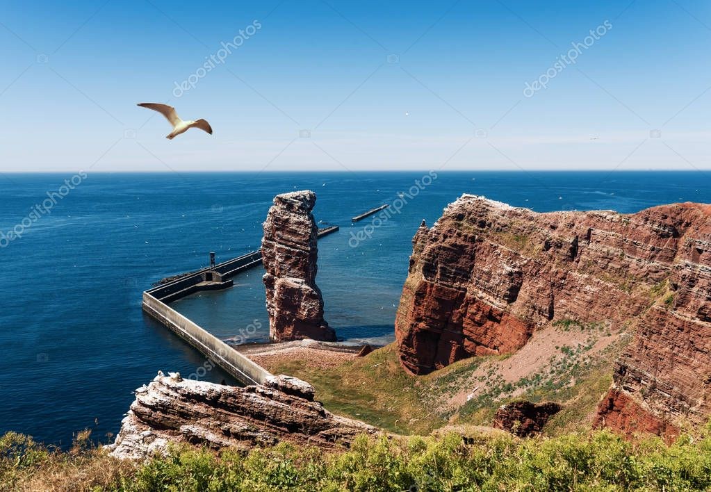 Lange Anna sea stack rock on Heligoland Island against blue sea and clear sky