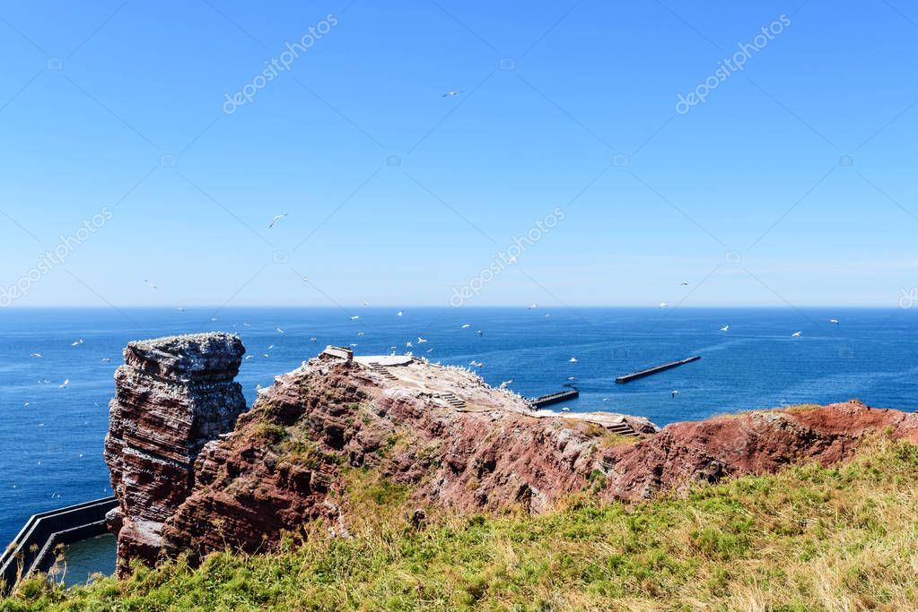 Lange Anna sea stack rock on Helgoland island against blue sea on clear day