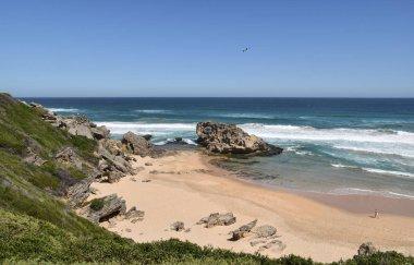 idyllic beach near Brenton-on-Sea on sunny summer day against blue sky and ocean