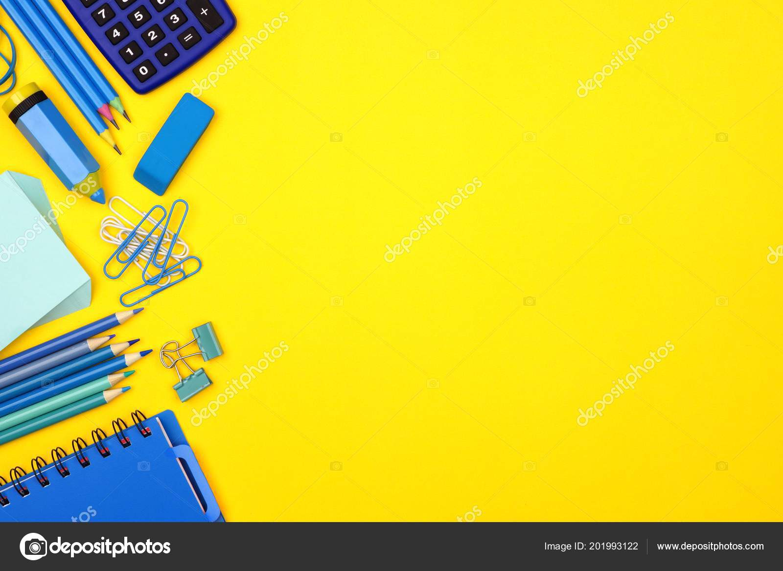 blue school supplies side border bright yellow paper background