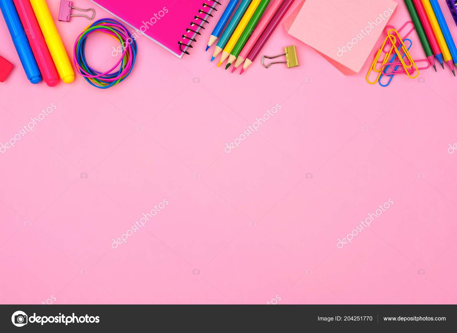 school supplies top border pastel pink paper background stock