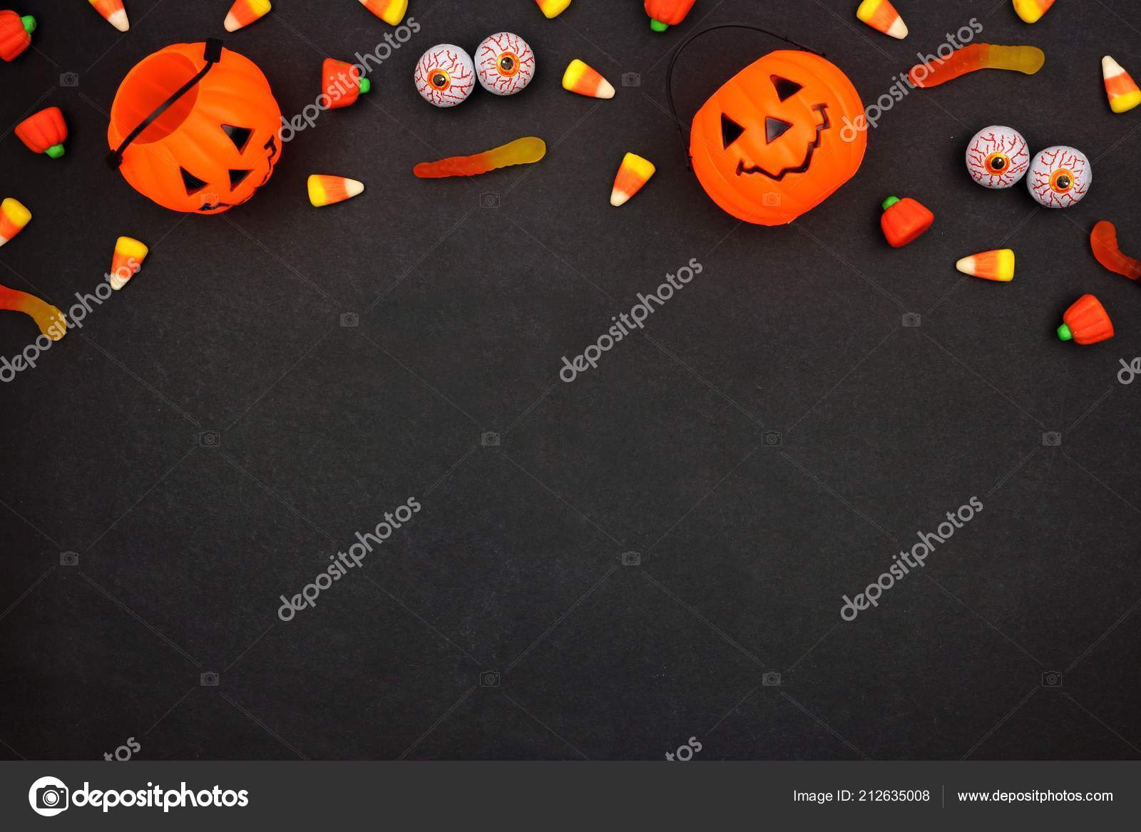 halloween candy top border dark black background copy space — stock
