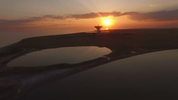 Amazing sunset over the sea and lake in Crimea.