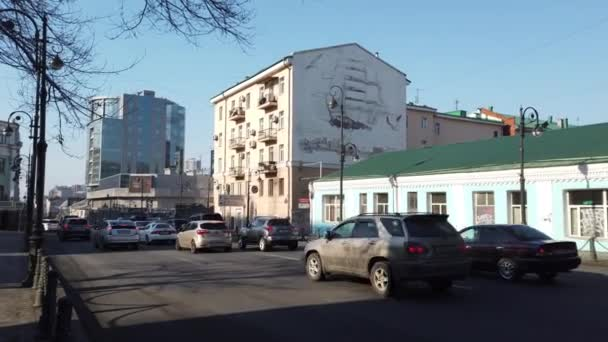 Vladivostok, Primorsky Krai - April 3, 2019: Urban landscape with a busy street and ancient architecture.