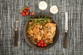 Fotografie Stewed pork chop in a bright mushroom sauce. Top view.