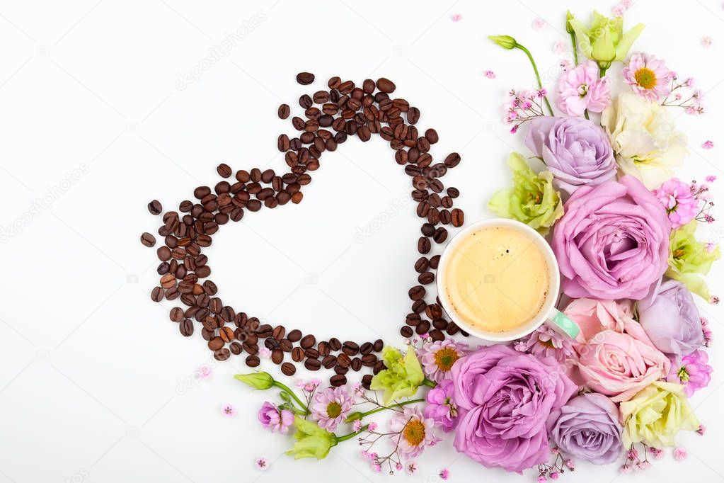 Festive concept for Valentine day or Mother's day with flowers, cup of coffee and coffee beans in shape of heart on white background. Valentine day greeting card, top view, flat lay.