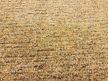 brown and yellow carpet or rug or fibers up close