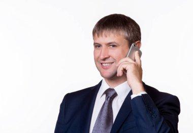 Happy Businessman Talking On Telephone Over White Background.