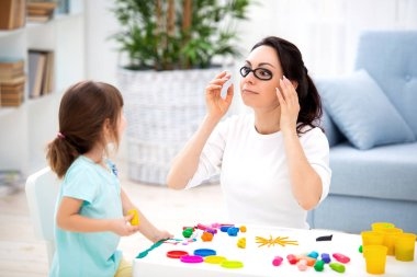 How to save healthy eyesight. Mom and daughter make glasses from plasticine