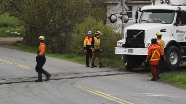 Alton, Canada - May 31, 2019: Footage of railroad crew or gang at a level crossing in Alton, Nova Scotia.