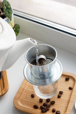 Drip, Brewing, pouring water over ground coffee contained in Vie