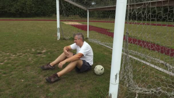 Disappointed soccer goalkeeper at the soccer football field gates