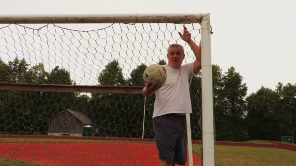 Angry soccer goalkeeper at the soccer football field gate