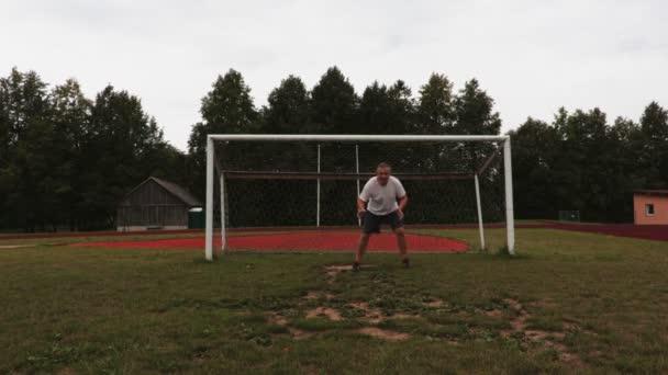 Stressful soccer goalkeeper in summer