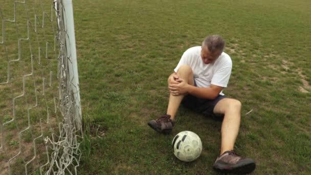 Football player with leg injury