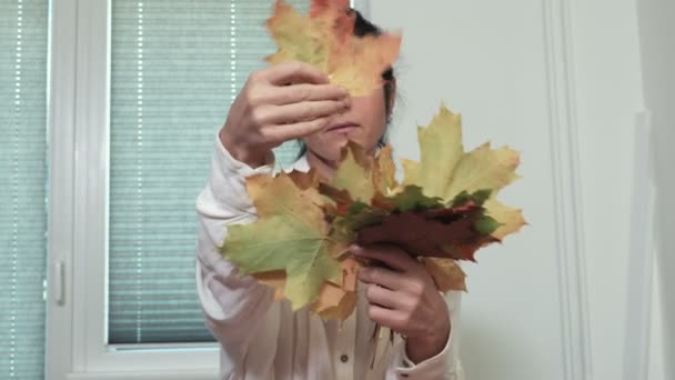 Woman with colorful maple tree leaves
