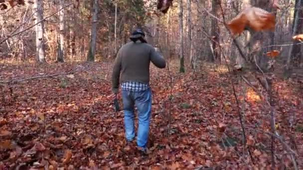 Camera follows person with knife and axe