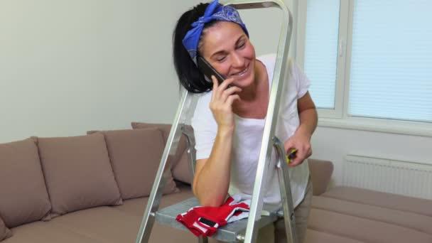 Happy woman speaks on smartphone