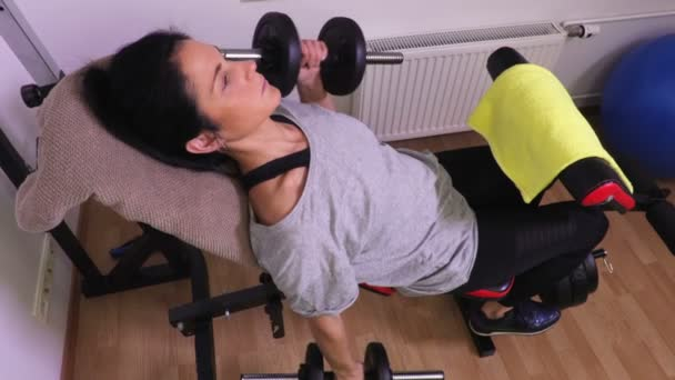 Women with dumbbells doing hammer exercise