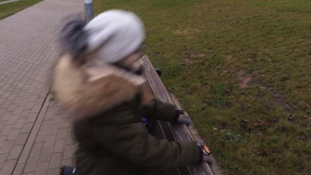 Hyperactive school girl on bench after school