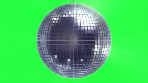 Rotační a zářící disco koule na zelené