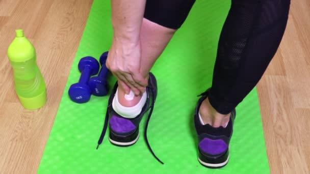Woman apply wound tape on leg injury