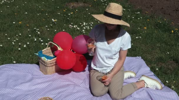 Woman sitting on the picnic blanket