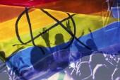 Silhouette einer Parade von Schwulen und Lesben mit Regenbogenfahne - Symbol für Liebe und Toleranz