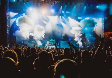 crowd at concert and stage lights with space for text
