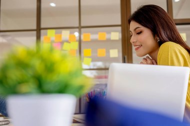 Business casual adviser analyzing financial figures denoting the progress Internal Revenue Service checking document. Audit concept