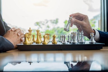 Hand of business moving chess figure in competition success play. Management concept