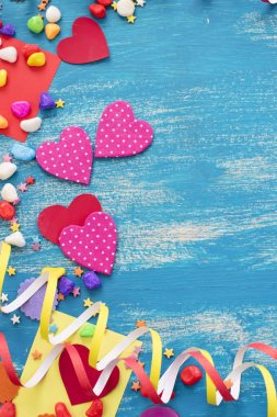 Festive confetti background heart candy color saturated.