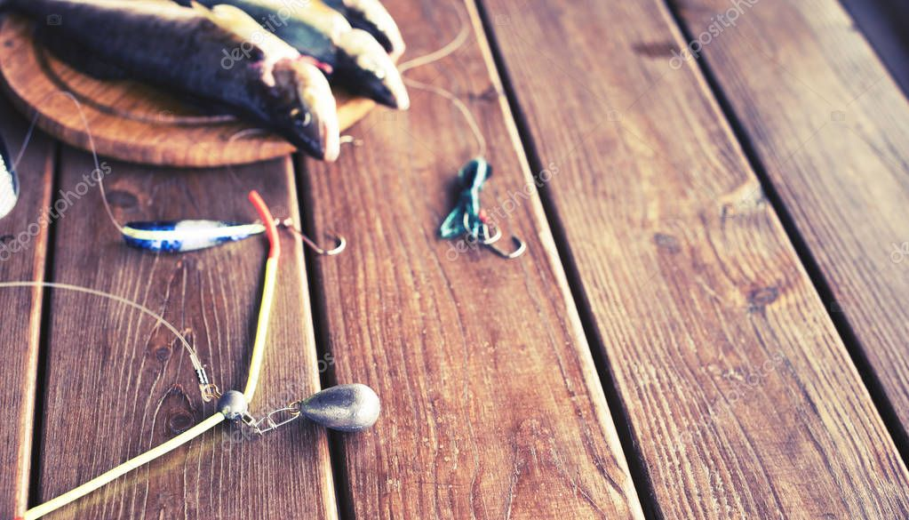 Banner catch of fresh sea fish lies on a cutting Board on a wooden table in the kitchen Selective focus copy space