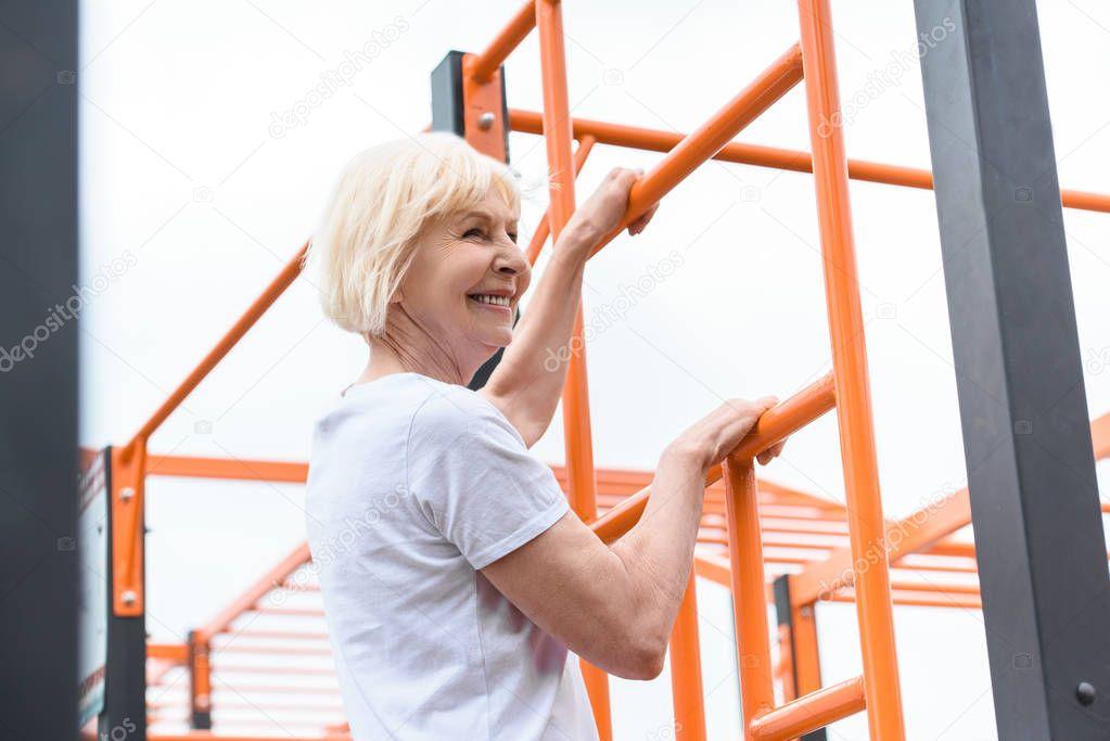 senior sportswoman training on sports ground