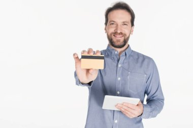 Portrait of smiling man with digital tablet showing credit card isolated on white stock vector