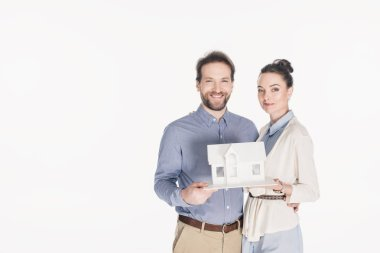 Portrait of married couple with house model isolated on white stock vector
