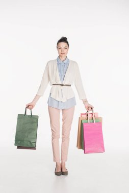 stylish woman holding shopping bags in hands isolated on white
