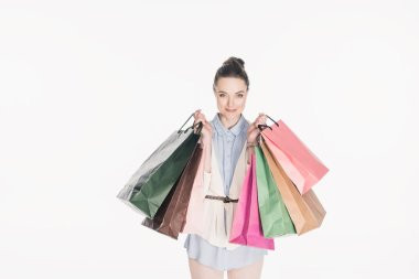 Portrait of smiling woman with shopping bags in hands looking at camera isolated on white stock vector