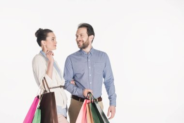 Portrait of cheerful couple with shopping bags isolated on white stock vector