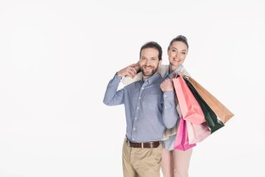 cheerful couple with shopping bags isolated on white