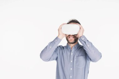 Smiling bearded man in virtual reality headset isolated on white stock vector