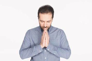 Portrait of bearded man in shirt praying isolated on white stock vector