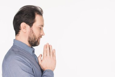 Side view of bearded man in shirt praying isolated on white stock vector