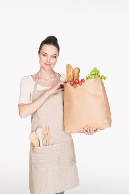portrait of woman with paper package with grocery isolated on white