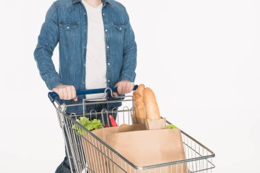 partial view of man with shopping cart full of paper packages with food isolated on white