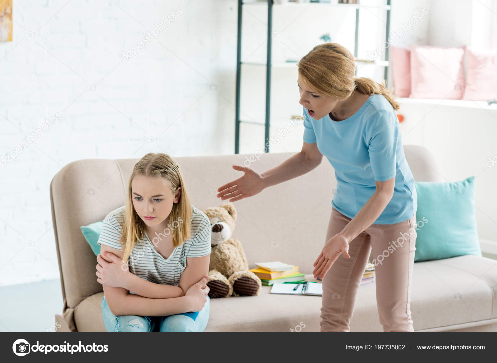 Angry mother yelling at teen daughter at home– stock image